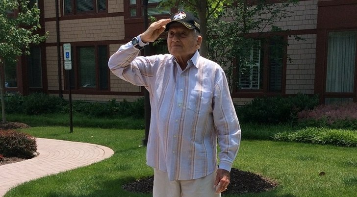 Veteran & Resident Of Sunrise At Fox Hill Honors The American Flag