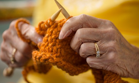 Close-up of senior hands knitting.