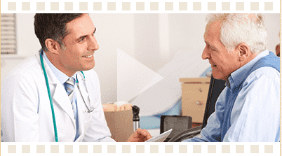 Doctor speaking to patient play button in foreground